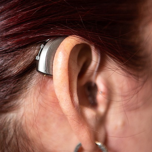 Behind The Ear Hearing Aid being worn